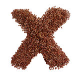 Letter X made with Linseed also known as flaxseed isolated on wh Stock Image
