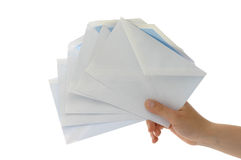 Letter for you. Hand with the envelope against the white background Royalty Free Stock Photo