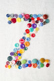 Letter Z of the alphabet of buttons of various shapes and colors Stock Image