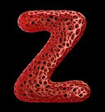 Letter Z made of red plastic with abstract holes isolated on black background. 3d Stock Images
