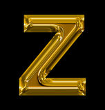 Letter Z rounded shiny golden isolated on black. Background Royalty Free Stock Images