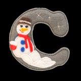 Lettera dell'alfabeto cirillico fatto di feltro isolato sul nero Fotografie Stock