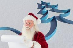 Lettera di Natale della lettura di Santa Claus Immagine Stock