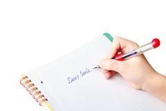 Lettera di scrittura della mano del bambino al Babbo Natale Fotografia Stock