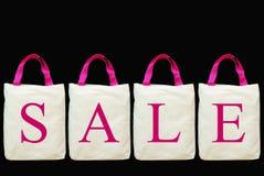 Lettera di vendita sul sacchetto di acquisto del tessuto Fotografia Stock