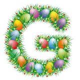 Lettera G della fonte di Pasqua fotografie stock