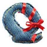 Lettera magica di alfabeto dei jeans di festa con il nastro rosso Fotografie Stock