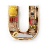 Lettera U Alfabeto dagli strumenti sul pegboard del metallo isolati Fotografia Stock