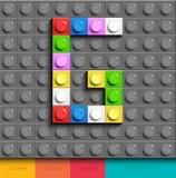 Lettera variopinta G dai mattoni di lego della costruzione sul fondo grigio di lego Lettera m. di Lego illustrazione vettoriale