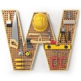 Lettera W Alfabeto dagli strumenti sul pegboard del metallo isolati Fotografia Stock