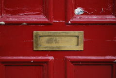 Letterbox. Red door with golden letterbox Royalty Free Stock Photography