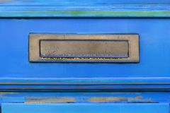 Letterbox on a blue door royalty free stock photo