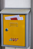 Letterbox full of mail Royalty Free Stock Image