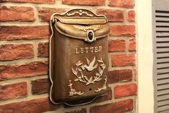 Letterbox, Mailbox. Beautiful vintage mailbox on a vintage brick wall stock photo