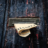 Letterbox in a old wooden door Stock Photos