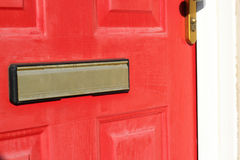 Letterbox in a red door. Royalty Free Stock Photos