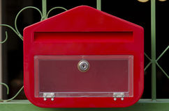 Postbox red. Letterbox perimeter fence home evening royalty free stock photo