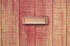 Letterbox and wooden door. Old wooden door with a brass letterbox Royalty Free Stock Photography