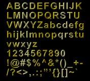 Lettere alfabetiche, numeri e simboli dorati Fotografie Stock