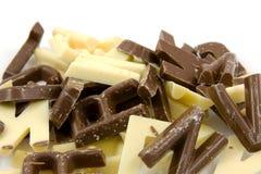 Lettere bianche e marroni della caramella di cioccolato Fotografia Stock
