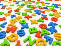 Lettere Colourful isolate su priorità bassa bianca Immagine Stock