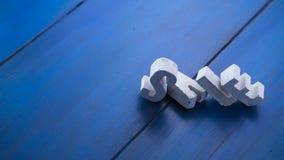 lettere concrete su un bordo di legno Fotografie Stock Libere da Diritti