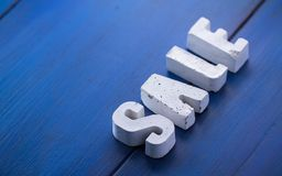 lettere concrete su un bordo di legno Immagini Stock Libere da Diritti