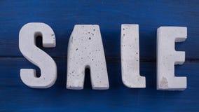 lettere concrete su un bordo di legno Fotografie Stock