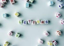 Lettere - cubi colorati che periodo & x22; letters& x22; Fotografia Stock
