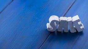 lettere del beton su un bordo di legno Fotografia Stock Libera da Diritti