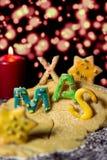 Lettere del biscotto con la pasta del biscotto e una candela, natale di parola con la st Fotografia Stock Libera da Diritti