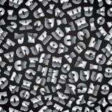 Lettere del metallo sul nero Fotografie Stock Libere da Diritti