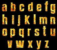 Lettere dell'alfabeto su fuoco Fotografie Stock