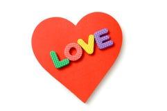 Lettere della gomma piuma e del cuore Immagine Stock