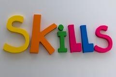 Lettere di abilità: Messaggio di testo su fondo bianco Fotografia Stock