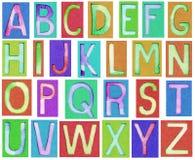Lettere di alfabeto fatte da carta e dall'acquerello Immagine Stock