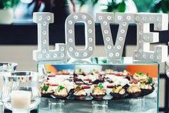 Lettere di amore con le luci Fotografia Stock