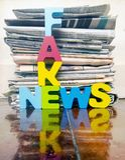 Lettere di legno di nuovo concetto falso Fotografia Stock Libera da Diritti