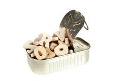 Lettere di legno in una latta Immagine Stock