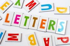 Lettere di parola fatte delle lettere variopinte Immagine Stock