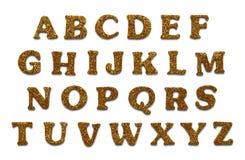 Lettere di scintillio dell'oro Fotografia Stock