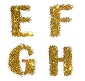 Lettere E, F, G, H della scintilla dorata di scintillio su fondo bianco Immagine Stock