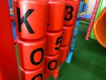 Lettere e gioco dei cilindri di numeri Fotografie Stock Libere da Diritti