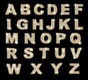 Lettere latine brillanti su priorità bassa scura Fotografia Stock