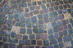 Lettere scolpite in pietre per lastricati grige Fotografia Stock