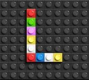 Lettere variopinte L dell'alfabeto dai mattoni di lego della costruzione sul fondo nero del mattone di lego fondo di lego lettere illustrazione di stock
