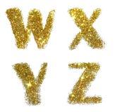 Lettere W, X, Y, Z della scintilla dorata di scintillio su fondo bianco Fotografia Stock