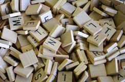 Lettered Wooden Tiles. A pile of lettered wooden playing pieces hand crafted and looking just like Scrabble Stock Photography