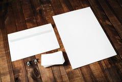 Letterhead, business cards and envelope. Blank letterhead, business cards and envelope. Photo of blank stationery set on vintage wooden table background. Mockup Stock Images