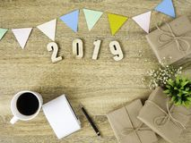 Lettering 2019 and all sorts of stationery items on the wooden surface royalty free stock photography